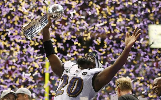 Baltimore Ravens player Ed Reed hoists the Vince Lombardi Trophy as he celebrates victory over the San Francisco 49ers in their NFL Super Bowl in New Orleans