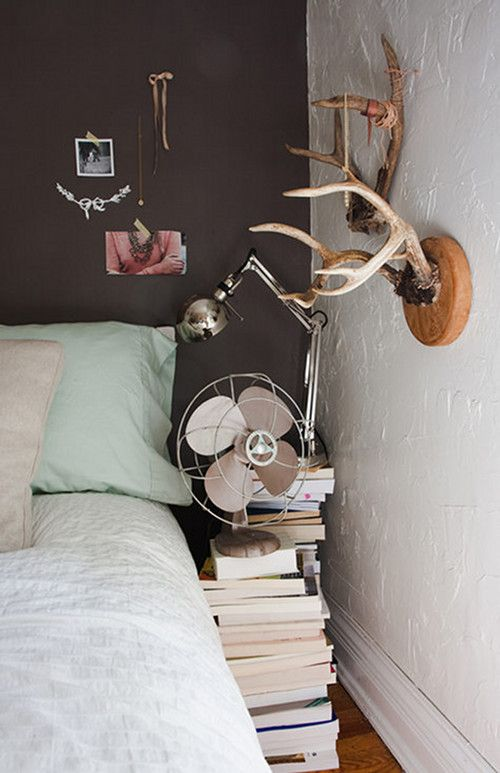 A dark brown makes the perfect backdrop for a bedside display of favorite things.