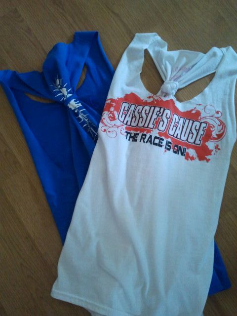 Upcycled big t-shirts into tanks.  These will be great for playing in the yard, working out and camping!!  I'm so glad to wear these tees that I wouldn't wear otherwise.