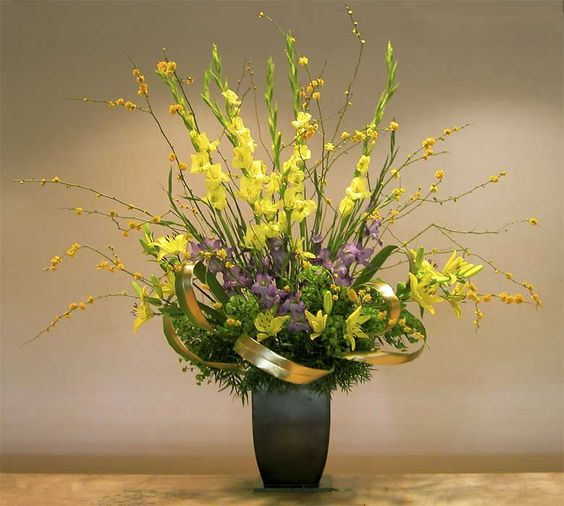 Holiday floral arrangements with succulents calla lilies for Floral arrangements with branches