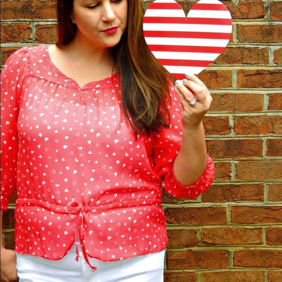 Red and White Heart Print Top Sheer red and white heart print top, so fun!!! Draw string tie waist so it can be as loose or tight as you want it. Charlotte Russe Tops Blouses
