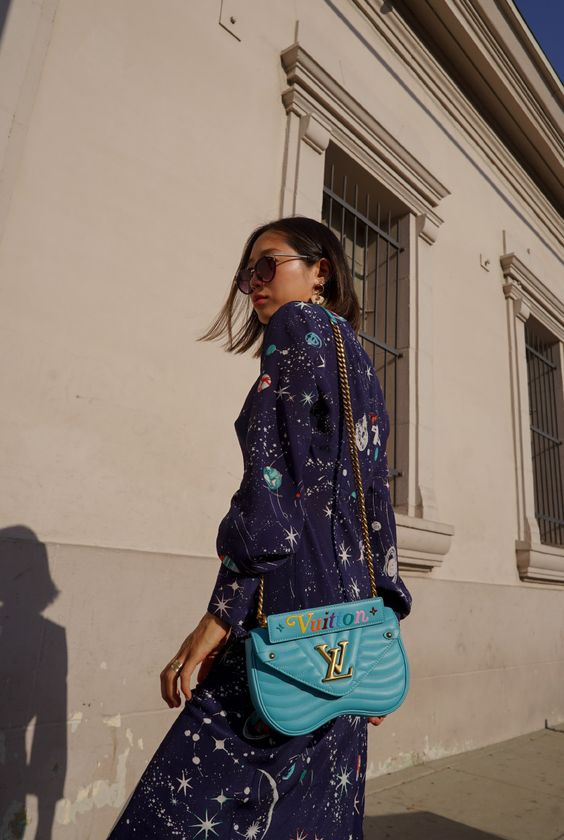 Aimee Song, fashion blogger of Song of Style, shares her favorite print of the moment, galaxy print and how to wear it with the new Louis Vuitton wave bag.