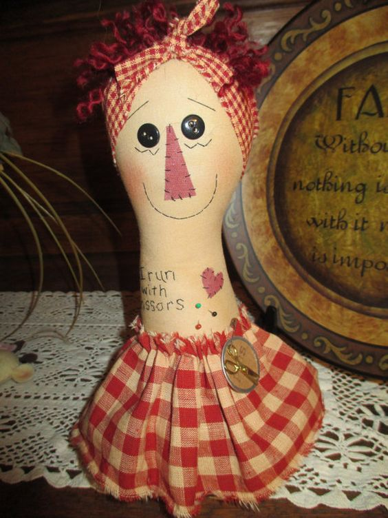 Approx. 10 inches tall, made of tea-dyed muslin,this prim Annie has an appliqued nose, stitched mouth and lashes, with black button eyes. A torn