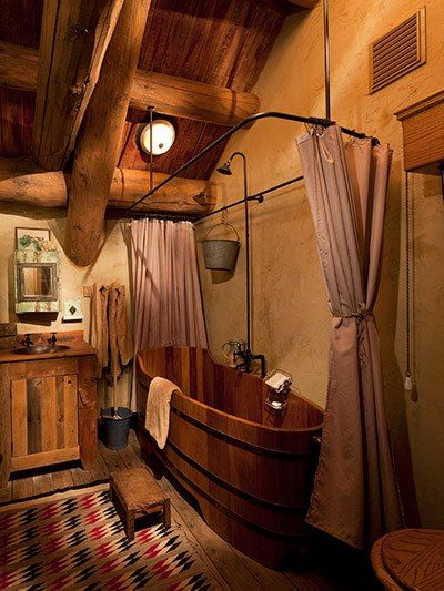 Charming rustic bathroom. Nothing like a depp bathtub and this is so cool. Maintenance would be the only issue. You would need to keep the wood cared for much like you would on a wooden yacht.
