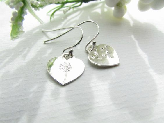 To go with my necklace :)  These beautiful earrings are made of two individually stamped sterling hearts - a dandelion and wish on one heart and wishes drifting away into