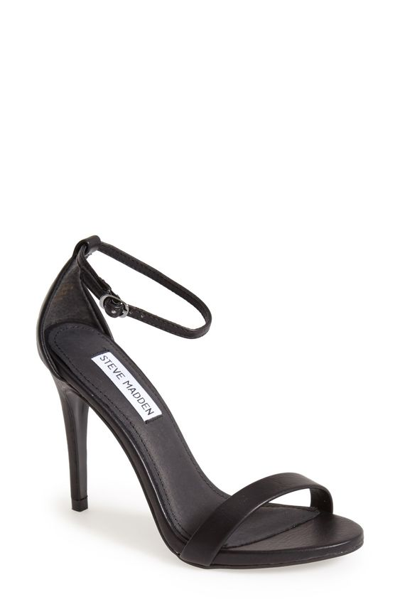 The slim ankle strap on these heels lends a dash of on-trend elegance to a clean, simplified sandal.