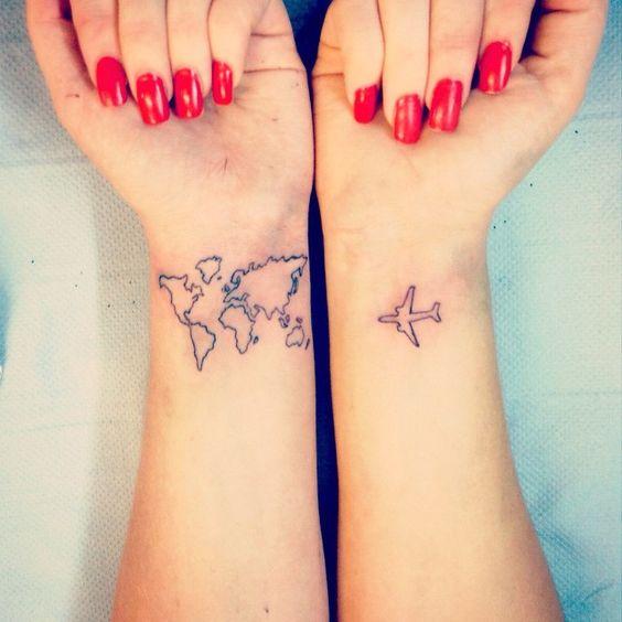 Map and plane wrist tattoo