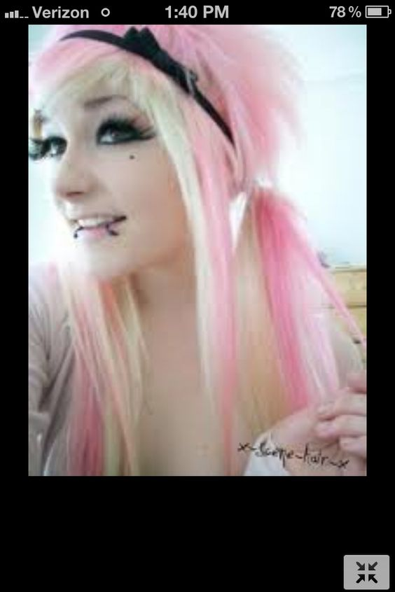 Bubblegum pink hair with a bleached-blonde under layer, pulled back, and straightened! c:   #musthave