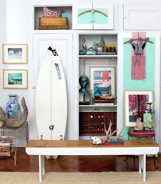 Eclectic #bedroom design with tons of wall art + #vintage #surfboard: