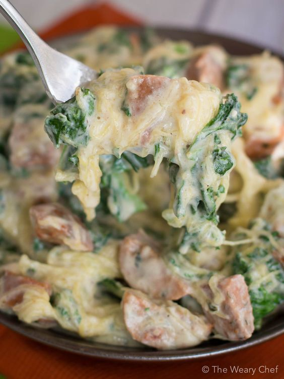 This healthy sausage alfredo recipe uses no cream and is served over spaghetti squash instead of pasta!