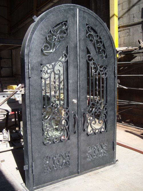 These Custom Built Rustic Wrought Iron Doors Will Give The Johnsons New Home An Elegant Entryway They Wanted A Doo Wrought Iron Doors Iron Doors Custom Door