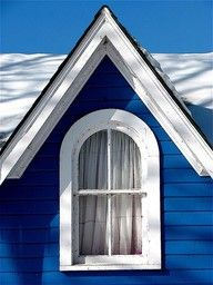 Deep cobalt or indigo blue house with white trim