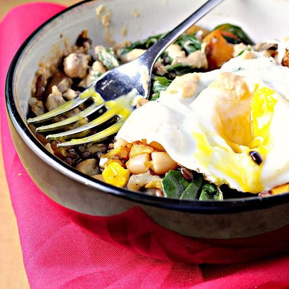 Za'atar roasted eggplant breakfast bowl with Swiss chard, butternut squash and hummous