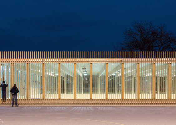 Jovan Mitrović wraps a glass-walled sports hall in timber battens