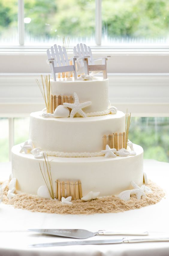 His and hers. Adirondack chairs as wedding cake toppers make any beach-themed wedding look straight out of the dunes.