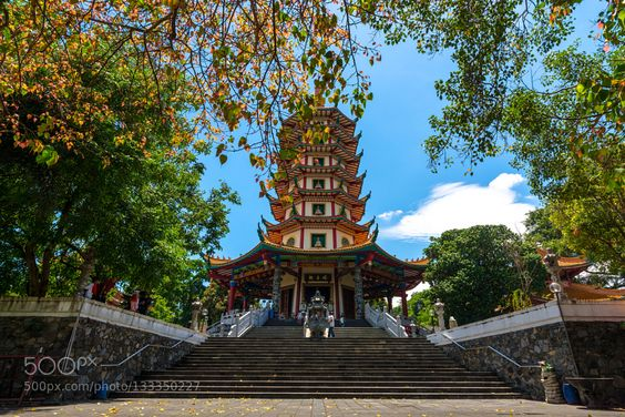 #Indonesiaarchitectureasiabuddhistbuildingcentral javacitycityscapehistoryjavalandmarkoldsemarangtourismtravel #roysingh0611 (December 24 2015 at 05:44AM) Watugong Buddhagaya Vihara is a Buddhist monastery which was inaugurated in 2006 and declared by MURI as the highest pagoda in Indonesia. Watugong Buddhagaya monastery is located 45 minutes from the center of Semarang. This monastery has many buildings and is in a large area. The most famous icon in this temple is the Pagoda Avalokitesvara (Metta Karuna). Pagoda Avalokitesvara who's height is 45 meters with 7 levels which means that a hermit will achieve sainthood in the seventh grade. Buddhagaya Watugong monastery is located 45 minutes from the central city of Semarang. This monastery has many buildings and are in a large area. One of the most famous icons in this monastery is Avalokitesvara Pagoda which has a height of 45 meters with seven levels and the dominance of red and some statues at each level pagodanya. Buddhagaya Avalokitesvara Pagoda is the tallest pagoda in Indonesia. In addition two large gazebo beside appear flanking each side which is used as a place of drums and bells which became one of the traditional pagoda completeness. Avalokitesvara Pagoda also known as the Pagoda or Pagoda Metakaruna Love Valentines because its existence to honor the figure of love and affection which is Kwan Im Po Sie Sat. Avalokitesvara Pagoda Buddhagaya has many privileges. Starting from the tile accessories stone reliefs from the ladder (9 dragons) a swimming dragon dragon lamps dragon fountain to sculpture phoenix and Kilin all imported from China. Also the pagoda is made up of seven levels. Each level has four statues of Goddess Kwan Im facing the four directions. Statue of Goddess who brought flowers and lotus can be used by visitors to pray that facilitated finding a wonderful mate. Statue of Goddess to bring daughter is intended for visitors who wish to have a daughter. Similarly the statue of Goddess who brings a ch boy used to pray so that visitors get the boys. One again the statue of Goddess Kwan Im visitors used to invoke a long life. Specifically at the level VII filled with four statues Amitaba. In addition to the statue of Goddess Kwan Im 24 and four statues Amitaba at the level I also put a big statue of Goddess Kwan Im with height 5.10 meters and a statue of Commander We Do. The total number of statues in the pagoda is 30 pieces. It's all part of the monastery complex neatly integrated with the beauty of its environment and coupled with the beauty of Chinese architecture making it a relatively pleasant place for pilgrimage and worship or just stop by to unwind due to break in transit.
