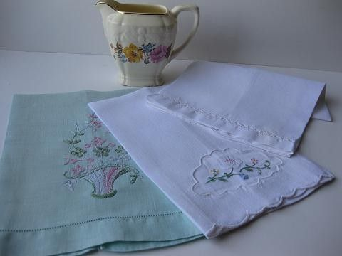 I collect and use antique linen tea towels. I use them as hand towels in the bathrooms.