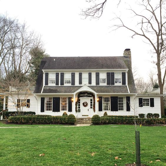White Dutch Colonial     Black Wood Shutters     Archway