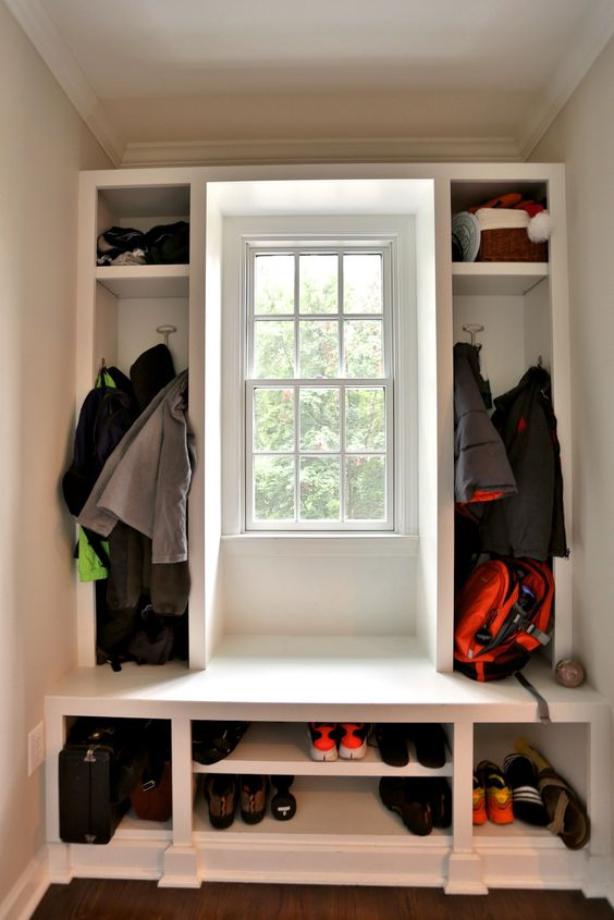 We fit this custom mudroom around a window on a small unused wall in this family's home.