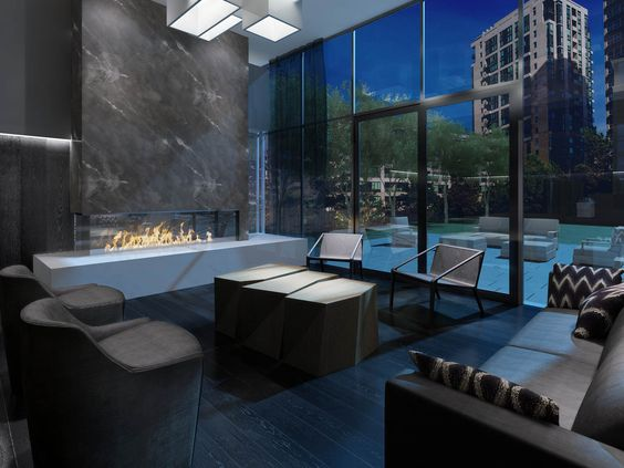 From the fireplace to the different chairs to the funky tables, this party room will make an impact. 101 Erskine condos, Yonge and Eglinton, Toronto.