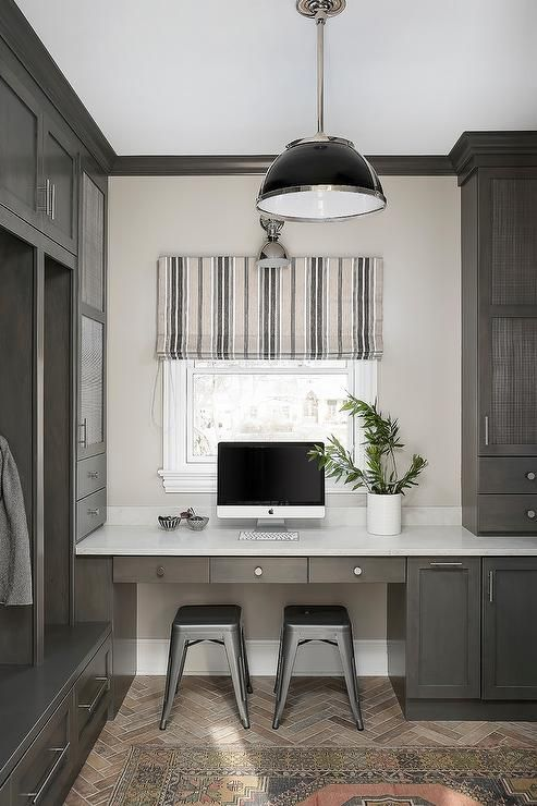This Well Styled Mudroom And Home Office Combo Features Silver Tolix Stools Placed On Red Brick Herringbone Pavers Beneath Kitchen Desks Home Office Decor Home My office space in mudroom