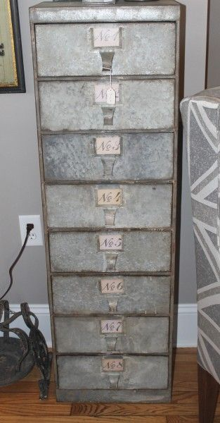metal cabinet w/ numbered drawers