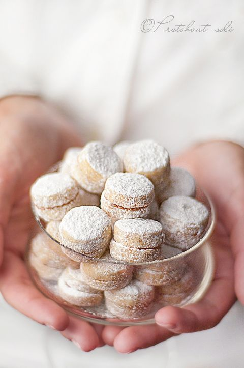Vanilices –almond cookies with jam, dusted with confectioners sugar