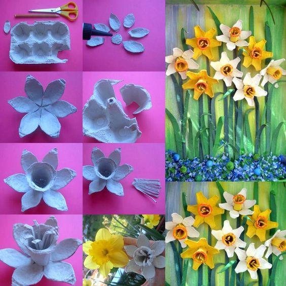 Flores em alto relevo na tela, feitas com caixas de ovos.