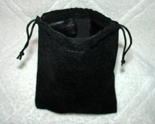 Medium Velvet Black Pouch With Drawstrings by NON-Label. $1.00. Unlined velvet pouch perfect for storing your jewelry, dice, coins or any other small item you care to keep covered.