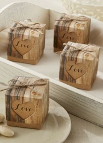 Reminiscent of a legendary tradition--carving true love's initials on a tree! Revive the custom with these rustic favor box design that shows guests your love will be strong and last long. Style 28164NA #davidsbridal #weddings #rusticweddings #weddingfavors