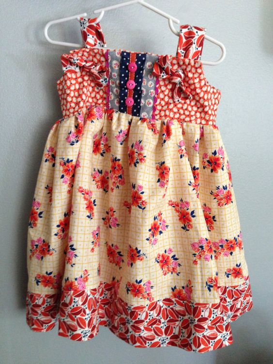 This beautiful knot-style dress is great for photo shoot or just perfect for Fall. It is embellished with rickrack, buttons and ribbon trim. www.threedandelions.com