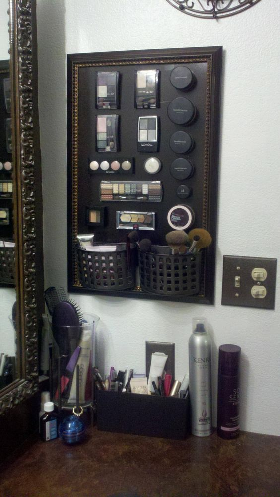 Make my own magnetic makeup board. Cheap frame from Dollar General, metal board from Ace Hardware, spray paint board n 2 plastic soap holders for brushes. Cut pieces of adhesive magnetic stripes and stick on back of makeup.  Whaalaa