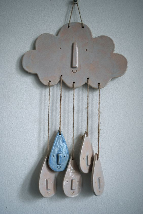 White ceramic cloud and raindrop wall hanging or mobile via Etsy.: