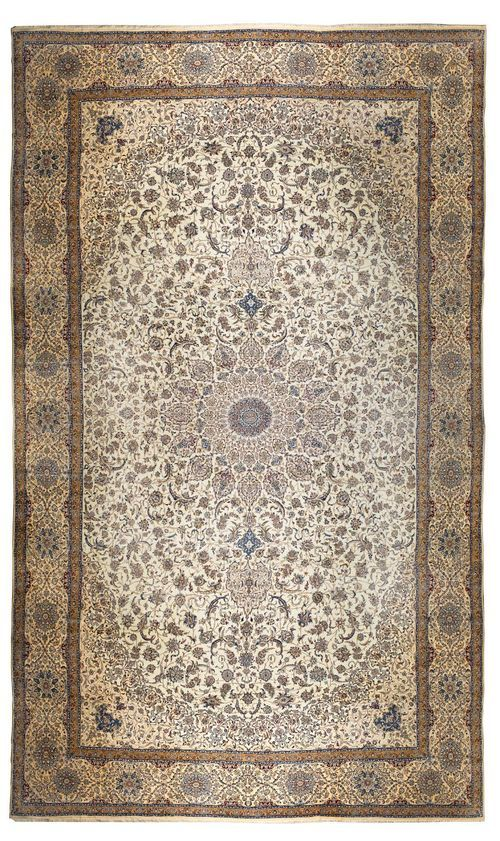 NAIN PALACE CARPET. White ground with a central medallion and beige corner motifs, finely patterned with trailing flowers and palmettes, beige border, good condition, 785x1350 cm.