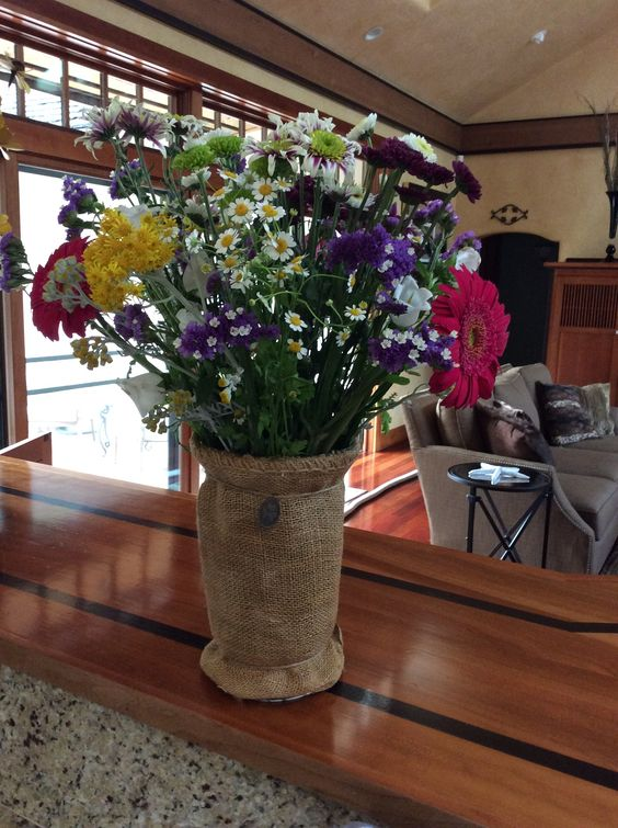 I wrapped a tall jar in burlap and hot glued it to the vase