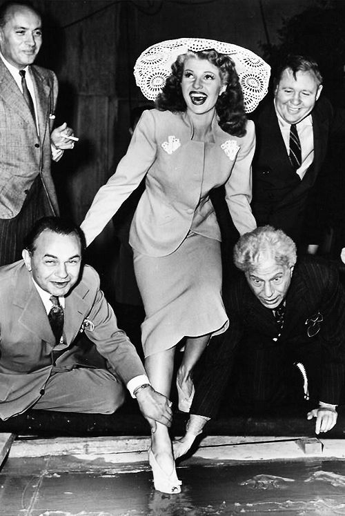 Rita Hayworth makes her mark at Graumanâs Chinese Theatre in Hollywood with Edward G. Robinson, Charles Boyer, Charles Laughton and Sid Grauman, 1942