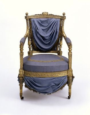 This arm chair once belonged to Marie Antoinette. Marie Antoinette's monogram (MA) is engraved at the top of the chair. It is unknown which of Marie Antoinette's palaces this chair came from, though it greatly resembles those from Saint-Cloud. It is currently held at the Victoria and Albert Museum: