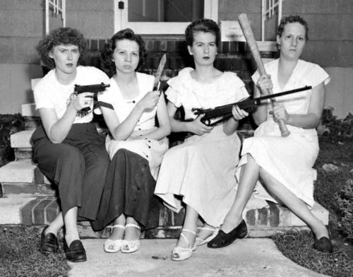 Pistol-packing mamas of Viers Mill Village, a Washington D.C., suburb, terrorized by night marauders for 3 weeks, rounded up four men in gun-fire studded chase early today. Wielding rifles, pistols, knives and baseball bats, the aroused housewives had the intruders begging for mercy when police reached the battlefield. Shown are Mrs. Mary Schultz, holding a .45; Mrs. Doris Young, carrying a butcher knife; Mrs. Martha Newell with a rifle, and Mrs. Warren Leigh, wielding a baseball bat. (1950)