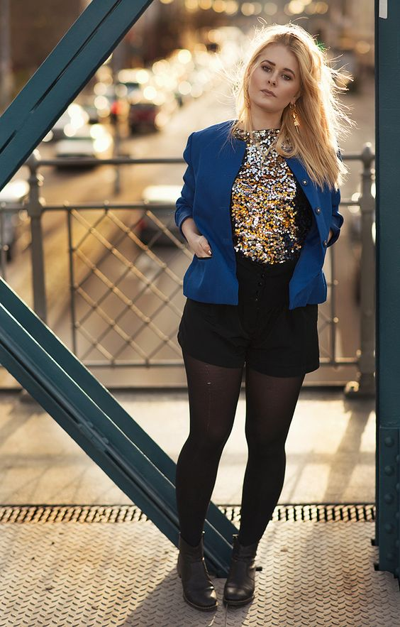 Christina Key is wearing a striking and pretty edgy fashion look with a golden shirt