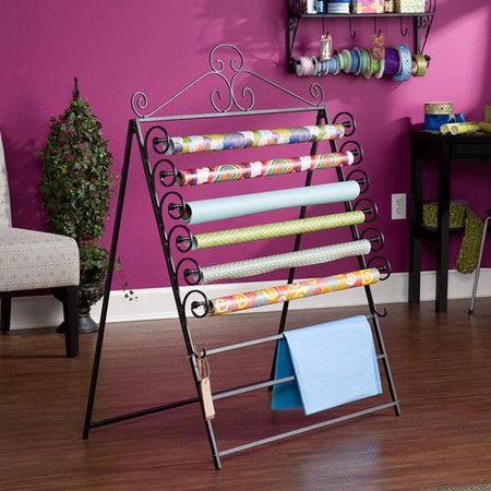 Scrolling metal craft rack with storage for 6 rolls of wrapping paper.  Product: Craft rackConstruction Material: $42- good to store my bangles