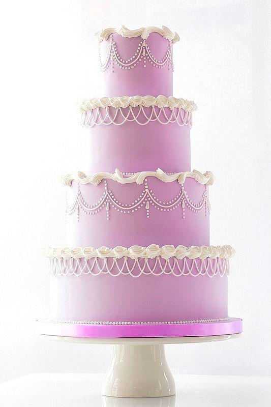 Regal lavender wedding cake For more wedding and fashion inspiration visit www.finditforweddings.com Purple wedding cake