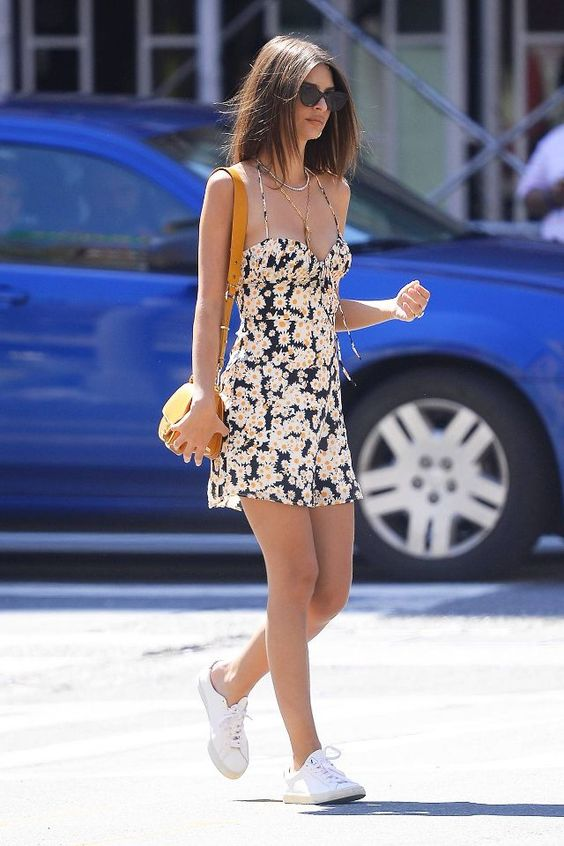 Emily Ratajkowski's sunny floral mini dress is the perfect summer outfit to wear with crisp white sneakers.