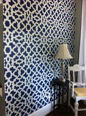 Love this blue and white feature wall stenciled with the Zamira stencil from Cutting Edge. -- Dining room feature wall