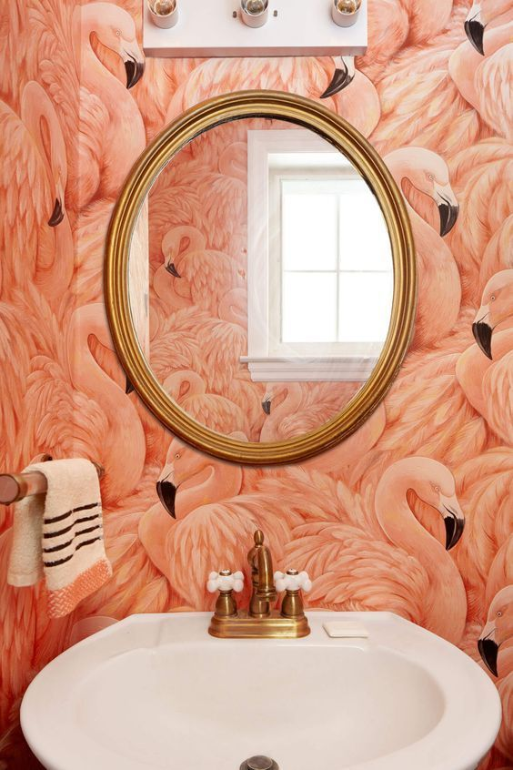 Make a statement in the bathroom with fun and creative wallpaper.: