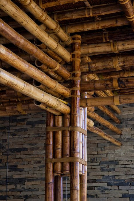 Clustered lengths of bamboo create a forest of columns inside this restaurant.: