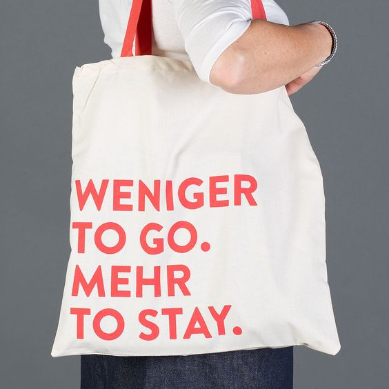 """Stofftasche """"Weniger to go. Mehr to stay."""" 