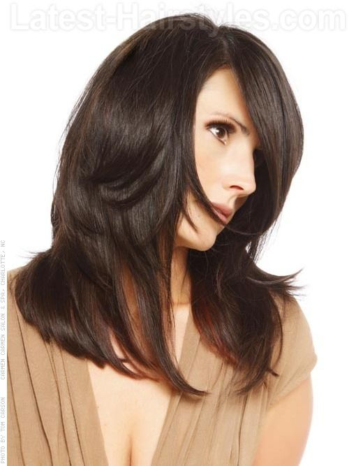 A long layered hairstyle for women with straight