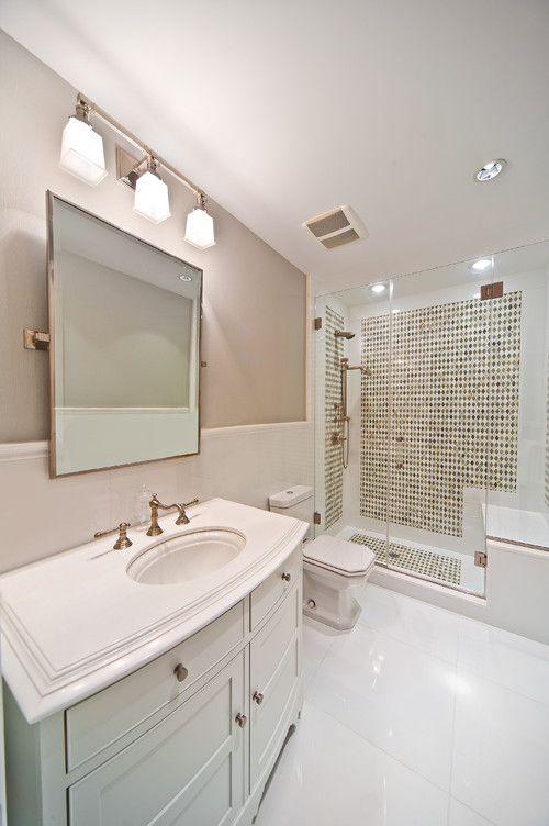 This windowless bathroom creates a coastal look with a for Windowless bathroom design ideas