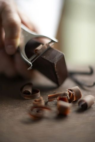 Easiest way to make chocolate curls? Slightly warm the bar of chocolate with the heat from the palm of your hand. Then use a wide peeler to create the curls.