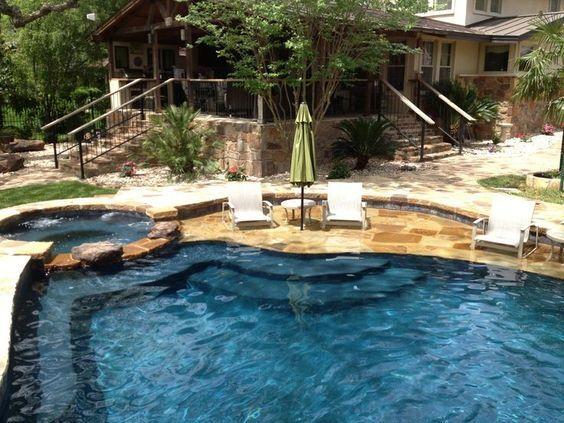 Stone Baja Shelf Entry Pool Level Spa With Stone Spillway Barbados Blue Quartzscapes Plaster Pool Houses Pool Remodel Backyard Pool